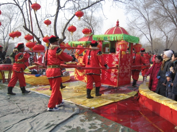 A Palanquin, where a bride sits and is carried to her groom.